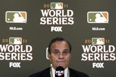 Major League Baseball executive vice president of baseball operations Joe Torre announces the cancellation of Game 6 of the World Series baseball championship due to poor weather in St. Louis Missouri October 26, 2011. REUTERS/Jim Young