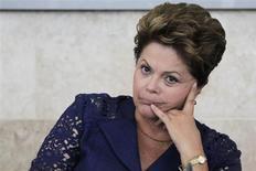 A presidente Dilma Rousseff participa do lançamento do Programa Inova Empresa, em Brasília, em março. Segundo a mais recente pesquisa CNT/MDA divulgada nesta terça-feira, 31,3 por cento dos entrevistados fizeram uma avaliação positiva do governo neste mês, queda ante 54,2 por cento em junho. 14/03/2013 REUTERS/Ueslei Marcelino