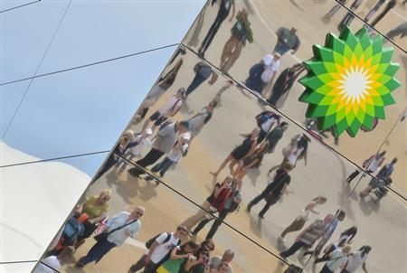 Spectators are seen reflected in a British Petroleum sponsors building in Olympic Park at the London 2012 Paralympic Games September 6, 2012. REUTERS/Toby Melville