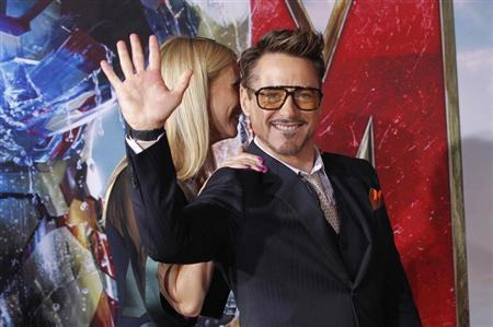 Cast member Robert Downey Jr. waves next to co-star Gwyneth Paltrow at the premiere of ''Iron Man 3'' at El Capitan theatre in Hollywood, California April 24, 2013. REUTERS/Mario Anzuoni