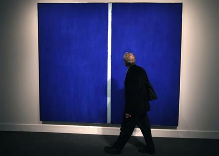 A visitor walks past Barnett Newman's 'Onement VI,' dated 1953 and estimated between $30 - 40 million, during a preview of Sotheby's May 14 Contemporary Art Evening Auction at Sotheby's in New York, May 3, 2013. REUTERS/Mike Segar/Files