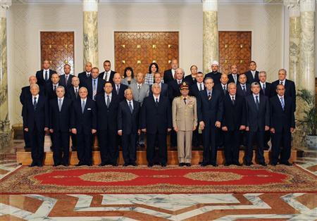 Egypt's interim President Adli Mansour (C) poses with new government ministers at El-Thadiya presidential palace in Cairo in this handout picture dated July 16, 2013. REUTERS/Egyptian Presidency/Handout