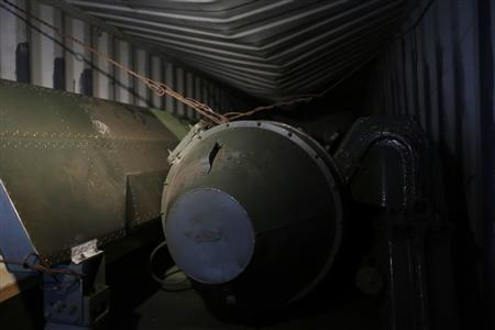 A long, green missile-shaped object is seen inside the North Korean flagged ship ''Chong Chon Gang'' docked at the Manzanillo Container Terminal in Colon City July 16, 2013. REUTERS/Carlos Jasso
