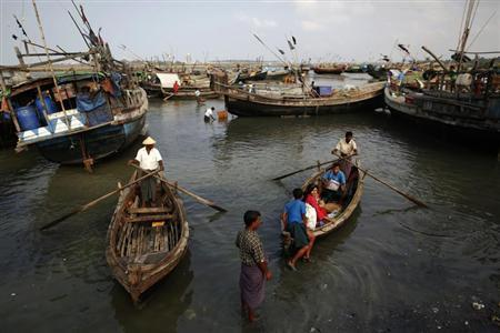 Rohingya people work on their boats near one of many camps for displaced Rohingya on Sittwe's outskirts April 27, 2013. Picture taken April 27, 2013. REUTERS/Damir Sagolj