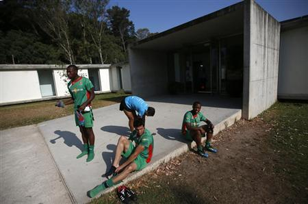 Portuguese out-of-contract players prepare before a training session organised by the Portuguese Association of Professional Footballers at the Estadio Nacional, outside Lisbon July 16, 2013. REUTERS/Rafael Marchante
