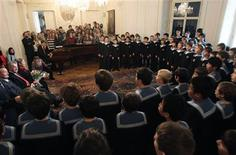 Members of the Vienna Boys' Choir perform during a visit of Austrian President Heinz Fischer (2nd L) at their home in Vienna, in this January 30, 2012 file photo. REUTERS/Heinz-Peter Bader/Files