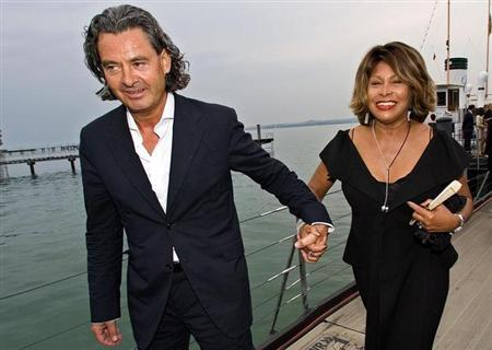 Singer Tina Turner (R) and her long-term German partner Erwin Bach (L) arrive for the premiere of Giacomo Puccini's ''Tosca'' at Lake Constance in Bregenz, July 19, 2007. REUTERS/Miro Kuzmanovic/Files