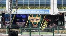 "A bus with an advertisement for the movie ""Kick-Ass 2"" drives past the San Diego Convention Center a day before the start of the 2013 Comic-Con in San Diego, California July 17, 2013. REUTERS/Fred Greaves"