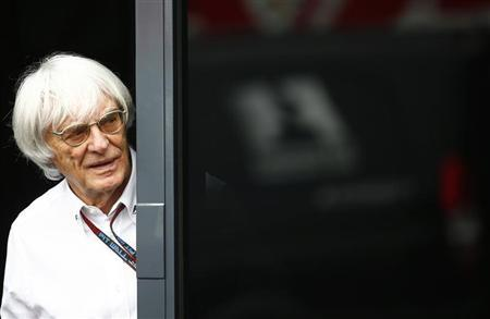 F1 commercial supremo Bernie Ecclestone looks out of his motor home after the second practice for the German F1 Grand Prix at the Nuerburgring racing circuit, July 5, 2013. REUTERS/Kai Pfaffenbach