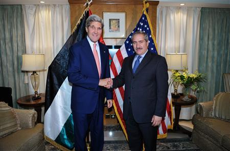 U.S. Secretary of State John Kerry (L) shakes hands with Jordanian Foreign Minister Nasser Judeh during a meeting at a hotel in Amman July 16, 2013. REUTERS/Mandel Ngan/Pool