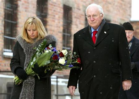 U.S. Vice President Dick Cheney (R) and his daughter Liz Cheney Perry walk inside the Auschwitz museum near former death camp Auschwitz-Birkenau to lay flowers at the wall of death in Oswiecim, January 28, 2005. REUTERS/Fabrizio Bensch FAB/MA - RTRLO5Z