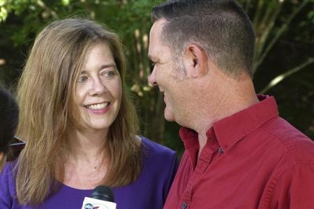 Melanie and Matt Capobianco talk to reporters in their suburban neighborhood near Charleston, South Carolina June 25, 2013. REUTERS/Harriet McLeod