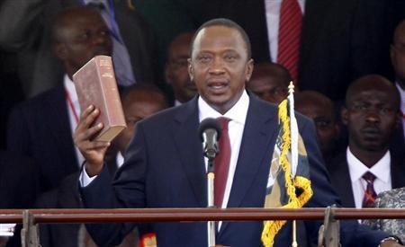 Kenya's President Uhuru Kenyatta takes the oath of office during the swearing-in ceremony at Kasarani Stadium in Nairobi, April 9, 2013. REUTERS/Thomas Mukoya
