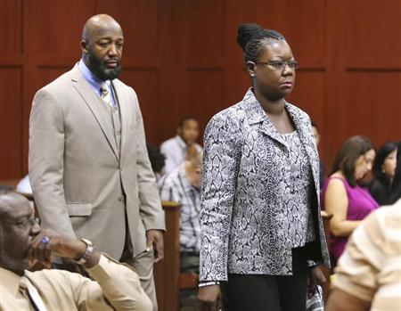 The parents of Trayvon Martin, Tracy Martin and Sybrina Fulton, arrive in the courtroom for the George Zimmerman trial in Seminole circuit court, in Sanford, Florida, July 9, 2013. REUTERS/Joe Burbank/Pool