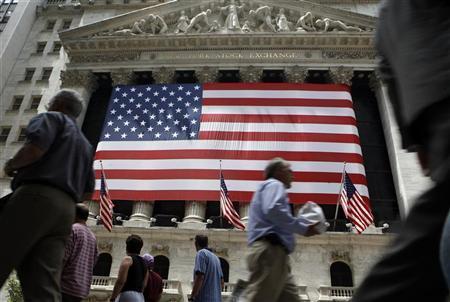 People walk past the New York Stock Exchange in New York July 13, 2007. REUTERS/Brendan McDermid/Files