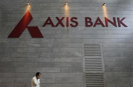 An employee speaks on his mobile phone as he walks inside Axis Bank's corporate headquarters in Mumbai July 17, 2012. REUTERS/Vivek Prakash