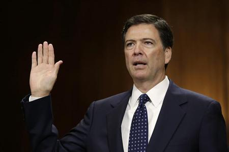 FBI director nominee James Comey is sworn in before testifying at the Senate Judiciary Committee on Capitol Hill in Washington July 9, 2013. REUTERS/Gary Cameron
