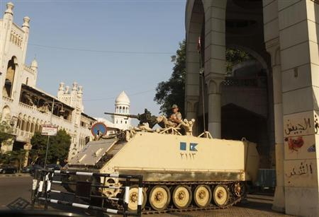 An Egyptian soldier keeps guard from atop a military vehicle in front of the presidential palace in Cairo July 14, 2013. REUTERS/Asmaa Waguih