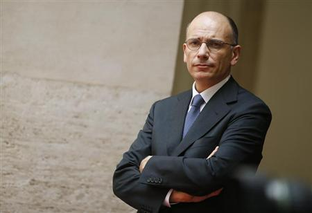 Italy's Prime Minister Enrico Letta looks on as he stands in the courtyard of Chigi Palace in Rome July 4, 2013. REUTERS/Tony Gentile