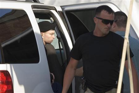 U.S. Army Private First Class Bradley Manning (L) arrives for the start of the sixth week of his court martial trial at Fort Meade, Maryland, July 8, 2013. REUTERS/Jonathan Ernst