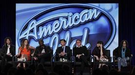 "(L - R) Steven Tyler, Jennifer Lopez, Randy Jackson, Ryan Seacrest, Ken Warwick, Cecile Frot-Coutaz and Mike Darnell of ""American Idol"" take part in a panel session at the FOX Winter TCA Press Tour in Pasadena, California January 8, 2012. REUTERS/Jonathan Alcorn"
