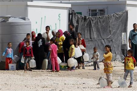 Syrian refugees wait to collect water at the Al Zaatri refugee camp in the Jordanian city of Mafraq, near the border with Syria June 25, 2013. REUTERS/Muhammad Hamed