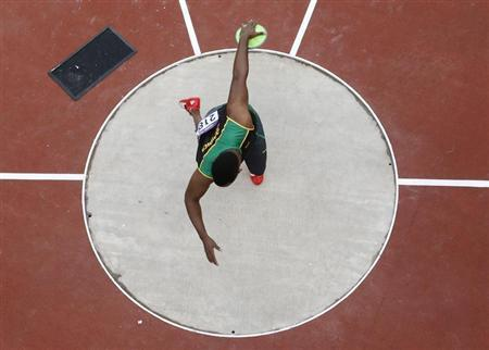 Jamaica's Traves Smikle competes in the men's discus qualification during the London 2012 Olympic Games at the Olympic Stadium August 6, 2012. REUTERS/Pawel Kopczynski