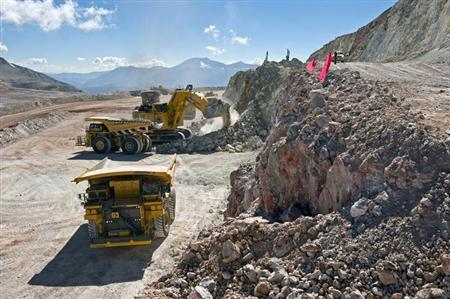 Mining machinery works at ''pre-stripping'' in the future open pit area of the Pascua-Lama mine straddling the Chile-Argentina border at about 5,000 metres above sea level in this January 21, 2012 handout photo obtained by Reuters July 27, 2012. REUTERS/Barrick/Handout