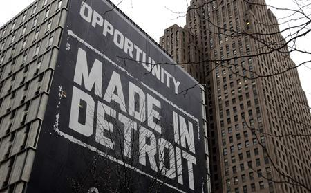 A large ''Opportunity Made In Detroit'' banner is seen on the side of a building in downtown Detroit, Michigan in this January 30, 2013 file photo. REUTERS/Rebecca Cook/Files