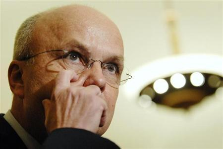 Former head of CIA Michael Hayden talks to reporters as he departs a closed-door session with the House Select Committee on Intelligence at the Capitol in Washington, December 12, 2007 file photo. REUTERS/Jonathan Ernst