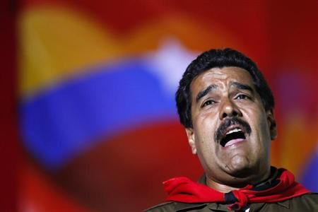 Venezuela's acting President and presidential candidate Nicolas Maduro sings during a campaign rally in Caracas April 5, 2013. REUTERS/Carlos Garcia Rawlins