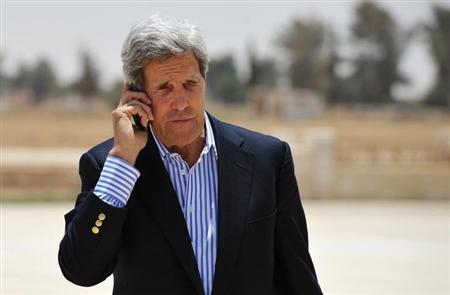 U.S. Secretary of State John Kerry speaks on the phone at Mafraq Air Base before boarding a helicopter to Amman, after visiting Zaatari refugee camp, July 18, 2013.REUTERS/Mandel Ngan/Pool