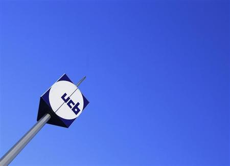 The logo of Belgian drug, chemical, and plastics group UCB is seen at the entrance of the company's headquarters in Brussels March 2, 2010. REUTERS/Yves Herman