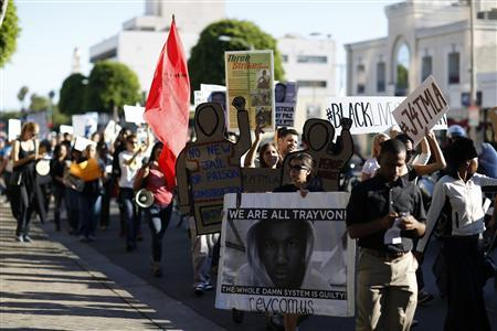 Demonstrators march to protest the acquittal of George Zimmerman in the killing of Florida teen Trayvon Martin in Beverly Hills, California July 17, 2013. REUTERS/Mario Anzuoni