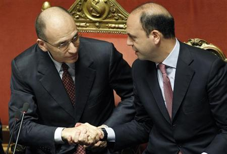 Italian Prime Minister Enrico Letta (L) shakes the hand of Italian Deputy Prime Minister and Interior Minister Angelino Alfano at the Upper house of the parliament in Rome, April 30, 2013. REUTERS/Giampiero Sposito