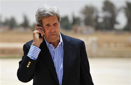 U.S. Secretary of State John Kerry speaks on the phone at Mafraq Air Base before boarding a helicopter to Amman, after visiting Zaatari refugee camp, July 18, 2013. REUTERS/Mandel Ngan/Pool