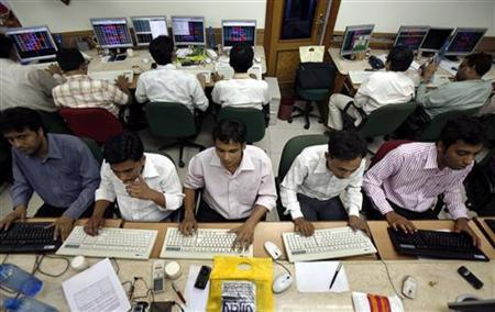 Brokers engage in trading on their computer terminals at a stock brokerage firm in Mumbai March 25, 2008. REUTERS/Punit Paranjpe/Files