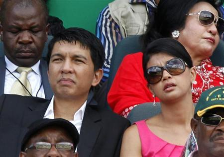 Madagascar's President Andry Rajoelina (L) sits next to his wife Mialy during the ANC's centenary celebration in Bloemfontein January 8, 2012. REUTERS/Siphiwe Sibeko