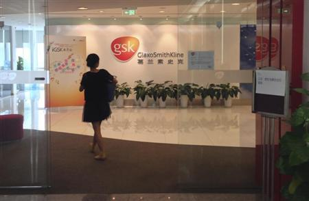 A Chinese employee walks into a GlaxoSmithKline (GSK) office in Beijing, July 19, 2013. REUTERS/Jason Lee