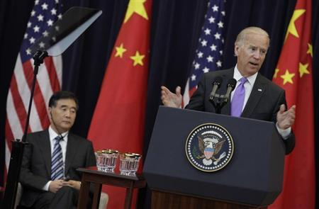 U.S. Vice President Joe Biden (R) speaks next to Chinese Vice Premier Wang Yang during the U.S.-China Strategic and Economic Dialogue (S&ED) Joint Opening Session at the State Department in Washington July 10, 2013. REUTERS/Yuri Gripas