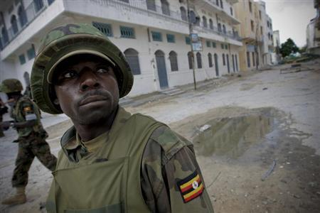 Ugandan soldiers serving with the African Union Mission in Somalia (AMISOM) patrol through the deserted streets of Bakara Market in central Mogadishu in a photograph released by the African Union-United Nations Information Support Team August 9, 2011. REUTERS/Handout/AU-UN IST PHOTO/Stuart Price
