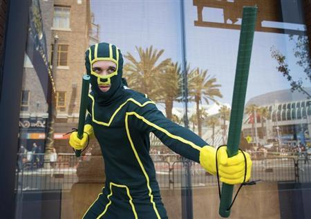 Cosplayer Travis Stapleton poses while dressed as comic book character Kick-Ass during the 2013 San Diego Comic-Con (SDCC) International in San Diego, California July 18, 2013. REUTERS/Fred Greaves