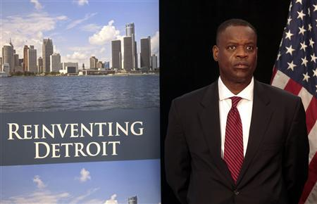 Detroit Emergency Manager Kevyn Orr waits to address the media during a news conference about filing bankruptcy for the city of Detroit in Detroit, Michigan July 19, 2013. REUTERS/ Rebecca Cook