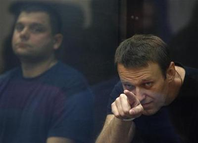 Russia opposition leader freed on bail, protests...