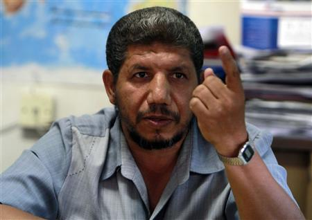 Ashraf Hussein, the Muslim Brotherhood's local spokesman, gestures during an interview in Assiut July 14, 2013. REUTERS/Mohamed Abd El Ghany