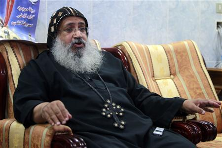 Louqa, a monk and a church leader, speaks during an interview in Assiut July 14, 2013. REUTERS/Mohamed Abd El Ghany