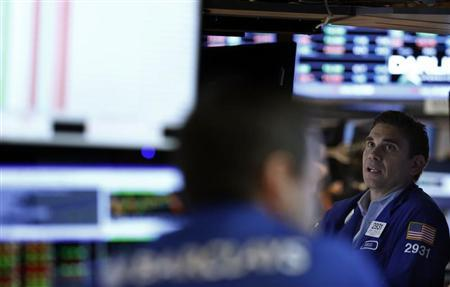 Traders work on the floor at the New York Stock Exchange, July 19, 2013. REUTERS/Brendan McDermid