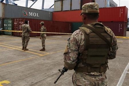 Soldiers stand guard near containers holding arms seized from the North Korean flagged ship ''Chong Chon Gang'' at the Manzanillo Container Terminal in Colon City July 17, 2013. REUTERS/Carlos Jasso
