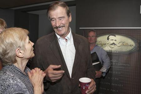 Former President of Mexico Vicente Fox (C) talks with Tana Lee Tolson (L), from Nurses Union for Cannabis Hospices, before a news conference held by commercial marijuana company Diego Pellicer Inc. in Seattle, Washington, May 30, 2013. REUTERS/Marcus Donner