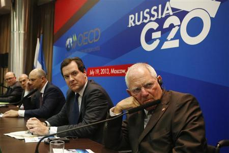 (From R-L) Germany's Finance Minister Wolfgang Schaeuble, Britain's Chancellor of the Exchequer George Osborne, Russia's Finance Minister Anton Siluanov, Angel Gurria, secretary-general of the Organisation for Economic Co-operation and Development (OECD), and France's Finance Minister Pierre Moscovici attend a news conference, part of the G20 finance ministers and central bank governors' meeting, in Moscow, July 19, 2013. REUTERS/Grigory Dukor